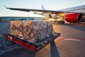 Air cargo charter aircraft being loaded for freight shipping from China